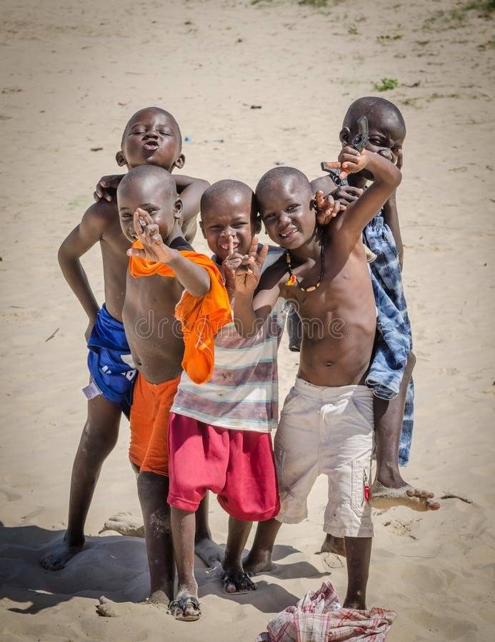 St Louis, Senegal - October 20, 2013: Portrait of friend group of unidentified African boys posing and having fun stock photography