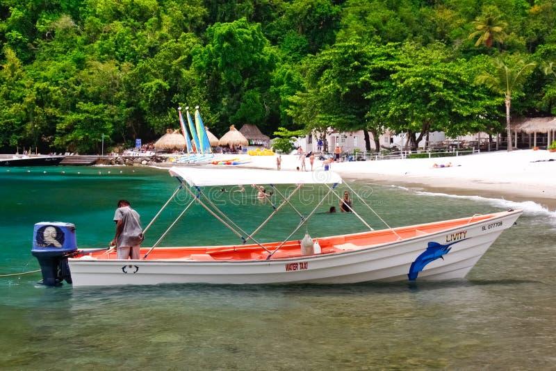 St. Lucia - de Taxi van het Water van het Strand van de Jaloezie royalty-vrije stock afbeelding