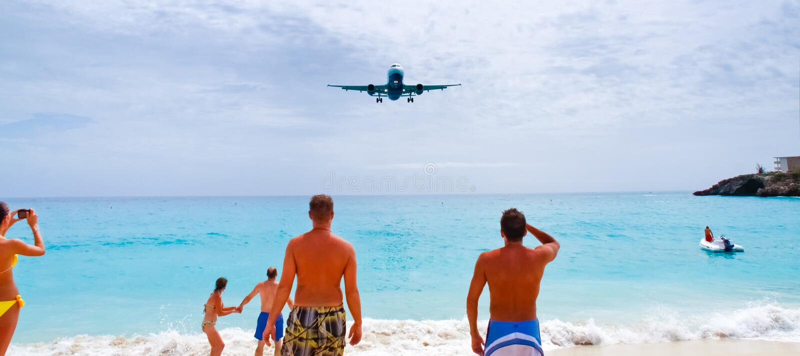 St. Maarten Maho Bay Watching Plane Landing stock photography