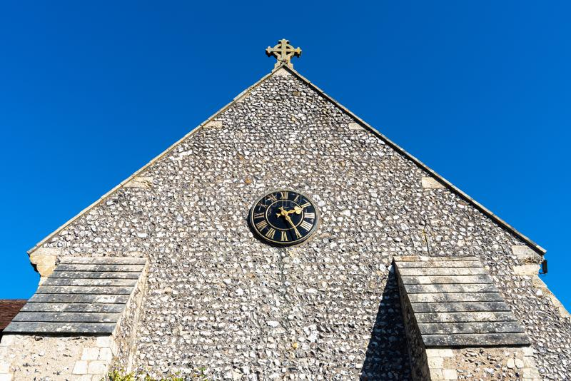 St Margaret`s Church, graveyard and cross sign in the village of Rottingdean, East Sussex, England. United Kingdom royalty free stock photos