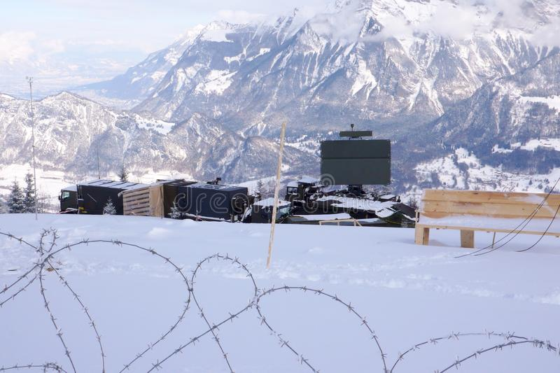 St. Margrethenberg, SG / Switzerland - January 31, 2010: military installation with barbed wire and radar during security measures royalty free stock photo