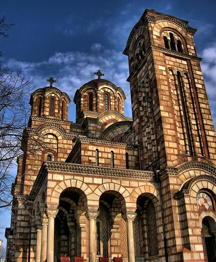 St. Mark Church in Belgrade. Orthodox church St. Mark. Blue sky and clouds. Cross on the dome royalty free stock photo