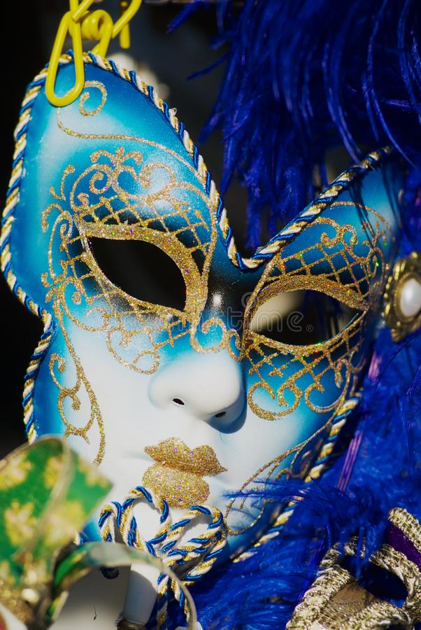 Close up of typical Venetian carnival masks with bright blue feathers. stock photo