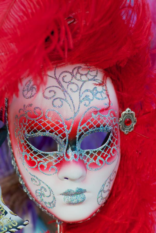 Close up of typical Venetian carnival masks with bright red feathers. stock photos