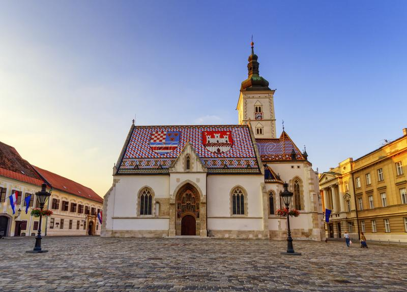 St. Mark`s Church and square in Zagreb, Croatia. St. Mark`s Church and square by sunset in Zagreb, Croatia stock photos