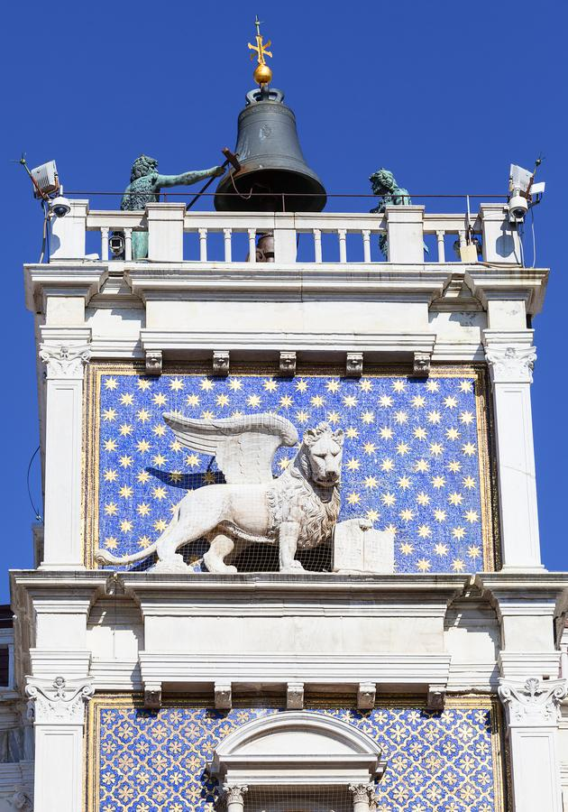 St Mark`s Clock tower on Piazza San Marco, Lion of Saint Mark ,Venice, Italy. St Mark`s Clock tower on Piazza San Marco, Lion of Saint Mark relief on facade royalty free stock photo