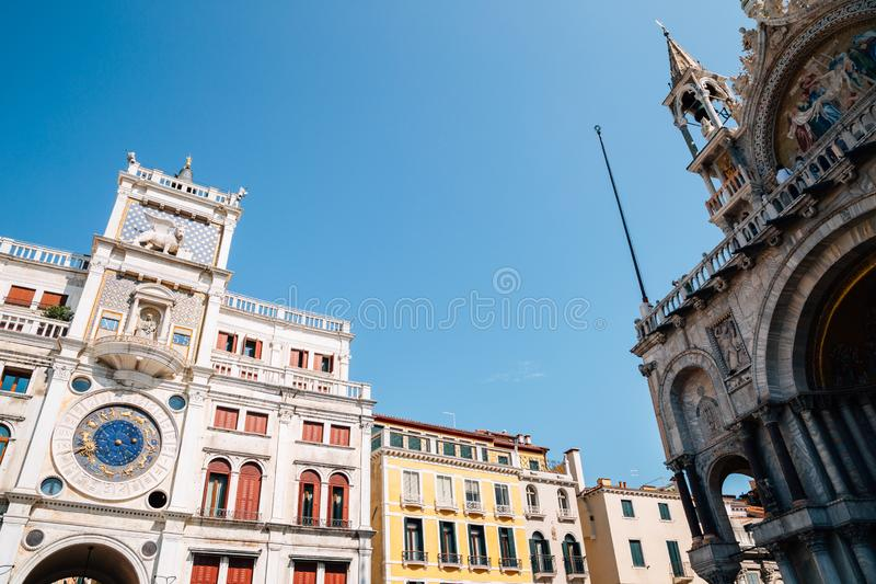 St Mark`s Clock tower Torre dell`Orologio and Basilica di San Marco in Piazza San Marco, Venice, Italy stock photography