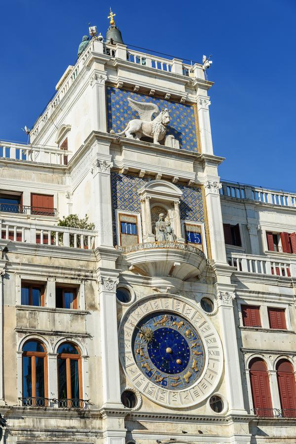 St Mark`s Clock tower or Torre dell`Orologio in Piazza San Marco. Venice. Italy royalty free stock image