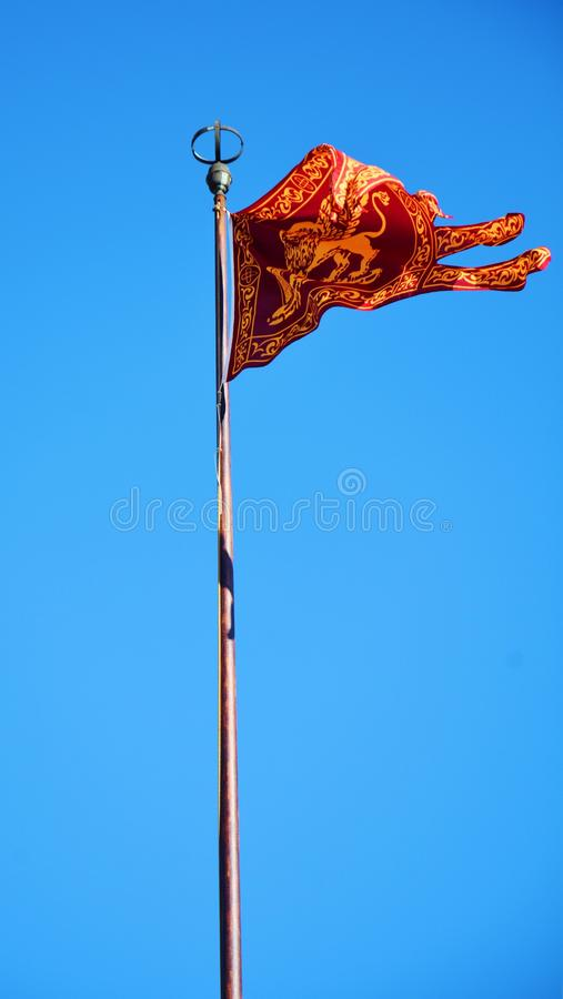 St. Mark`s Square and Venetian flag, in Venice, Italy stock image