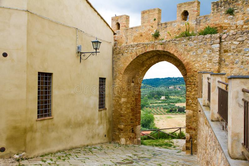 St. Martin gate in the town of Magliano in Toscana, Italy royalty free stock photography