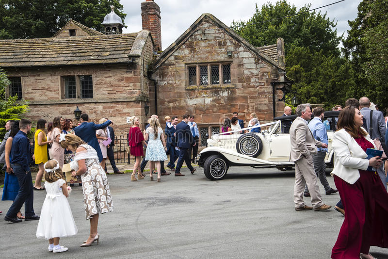 St Mary's Parish Church and Schoolhouse in Nether Alderley Cheshire. Wedding party at St Mary`s Parish Church. Set in the rural countryside of Nether stock image