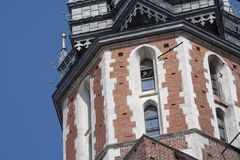 St. Mary`s Basilica Church of Our Lady Assumed into Heaven in Krakow / Cracow, Poland. Trumpeter, bugler playing a bugle call royalty free stock photos