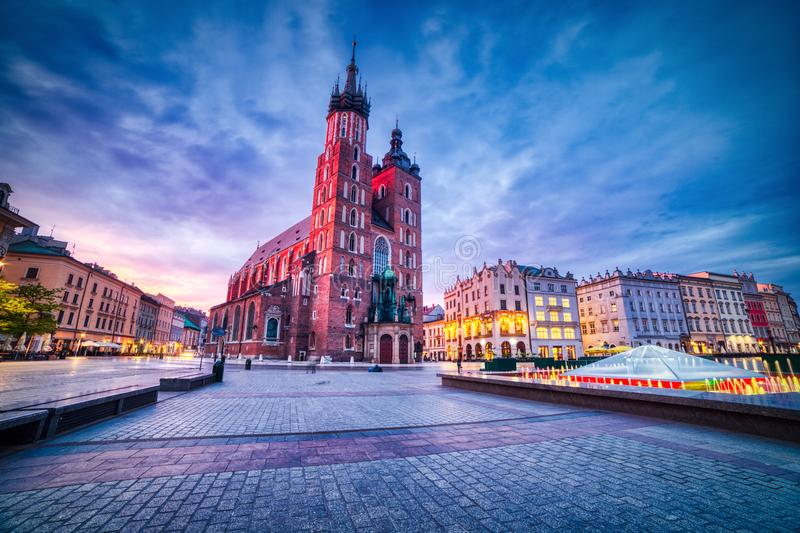 St. Mary`s Basilica on the Krakow Main Square at Dusk, Krakow. Poland stock images