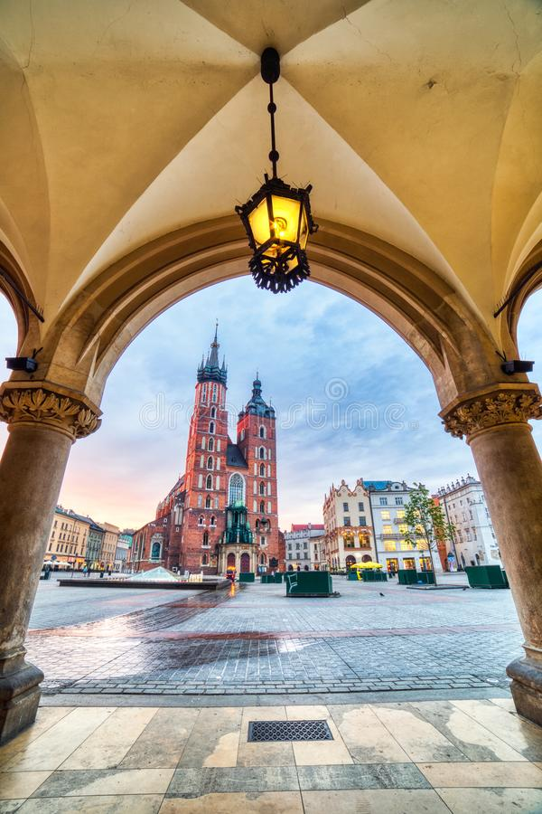 St. Mary`s Basilica on the Krakow Main Square at Sunrise, Krakow, Krakow. St. Mary`s Basilica on the Krakow Main Square at Sunrise, Krakow, Poland royalty free stock images