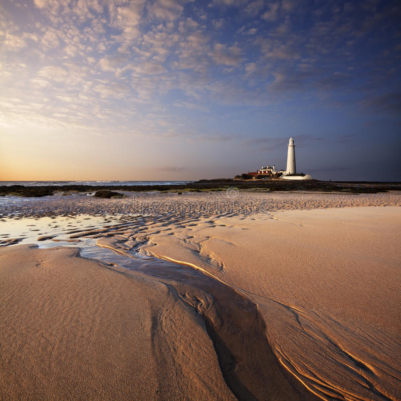 St. Mary's Lighthouse at sunset stock images