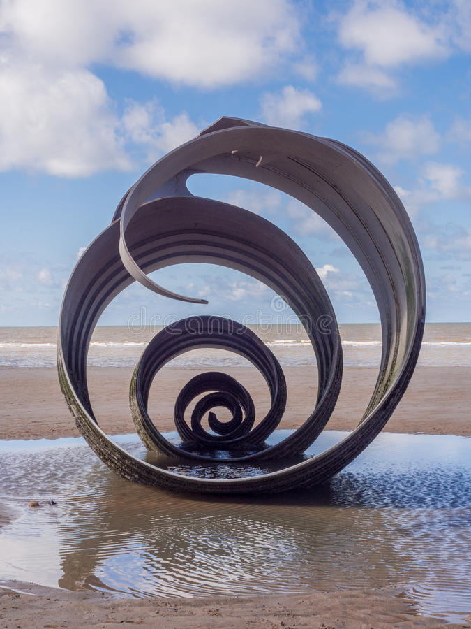 St mary's shell. Cleveleys, Lancashire, UK. April 17th 2016 St Marys shell sculpture at low tide, Cleveleys, Lancashire, UK stock photos