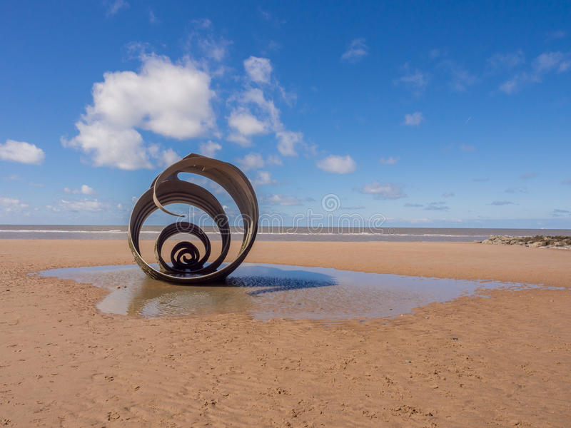 St mary's shell. Cleveleys, Lancashire, UK. April 17th 2016 St Marys shell sculpture at low tide, Cleveleys, Lancashire, UK royalty free stock photos
