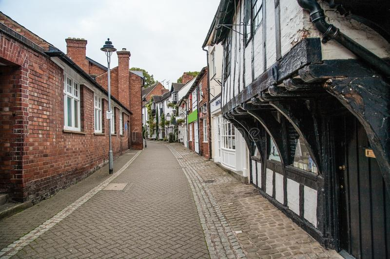 S Marys passage in Stafford uk with old buildings. St Marys passage in the town centre of Stafford, Staffordshire, united kingdom is an old street with black and royalty free stock images