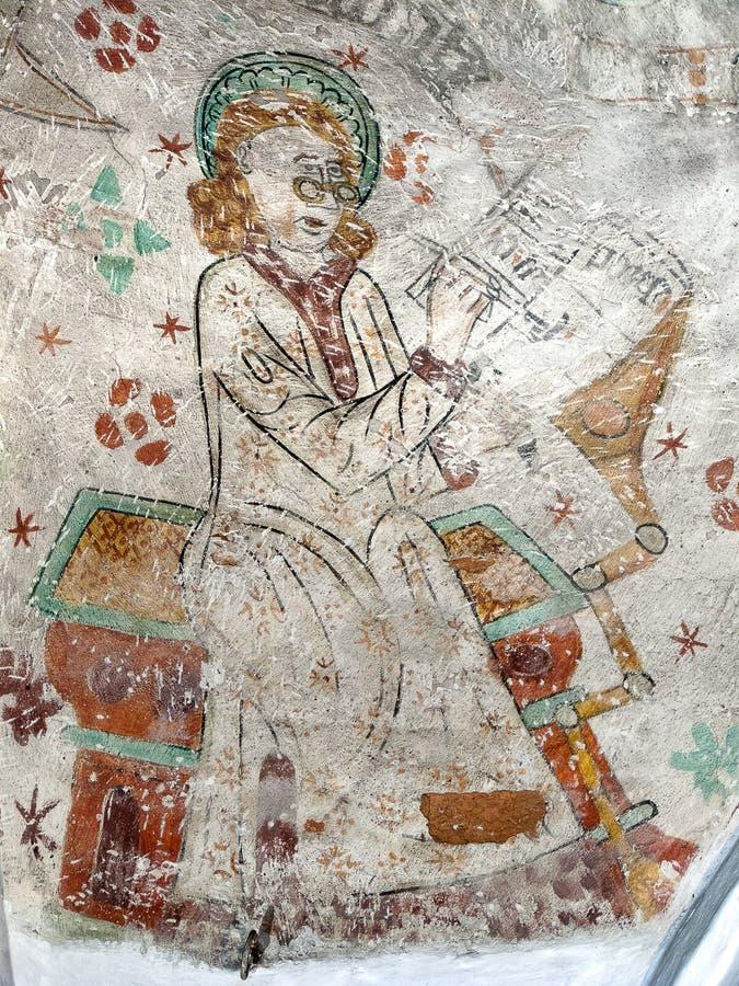 St Matthew skriver hans evangeliumbok royaltyfria foton