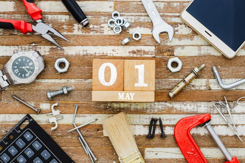 1st May. Happy International Worker's day or Labour Day background concpet.  wooden block calendar 1 May and handy tools and. Office men's accessories stock image