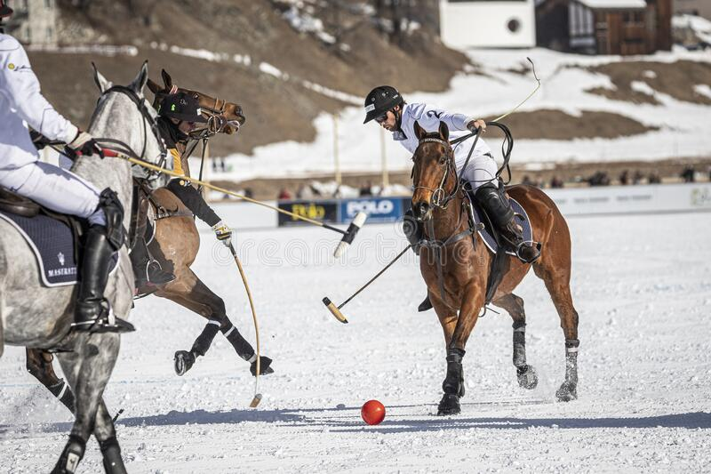 St. Moritz Switzerland - The final of the Snow Polo World Cup 2020. St. Moritz Switzerland - January 26, 2020 - The final of the Snow Polo World Cup is played on royalty free stock image