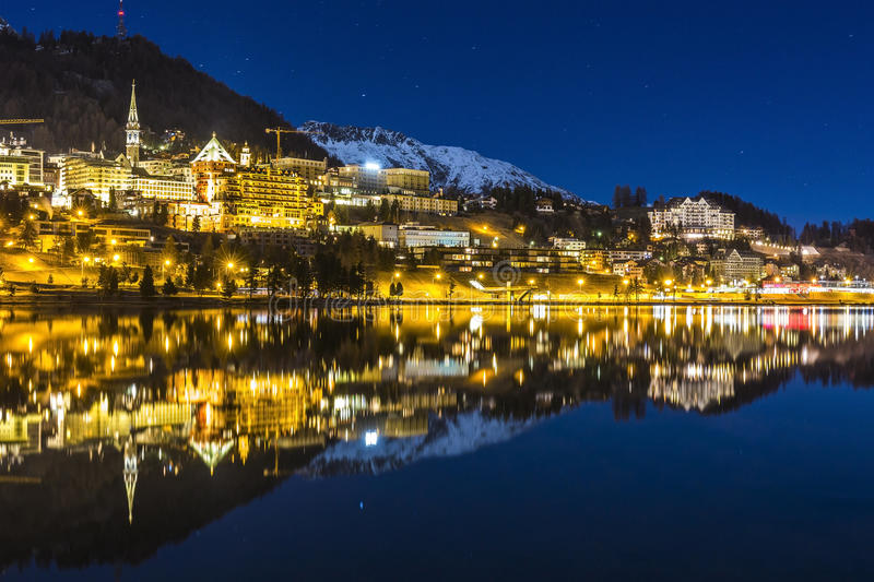 St Moritz in Switzerland. Night landscape of St Moritz reflected in the lake in Switzerland royalty free stock photo