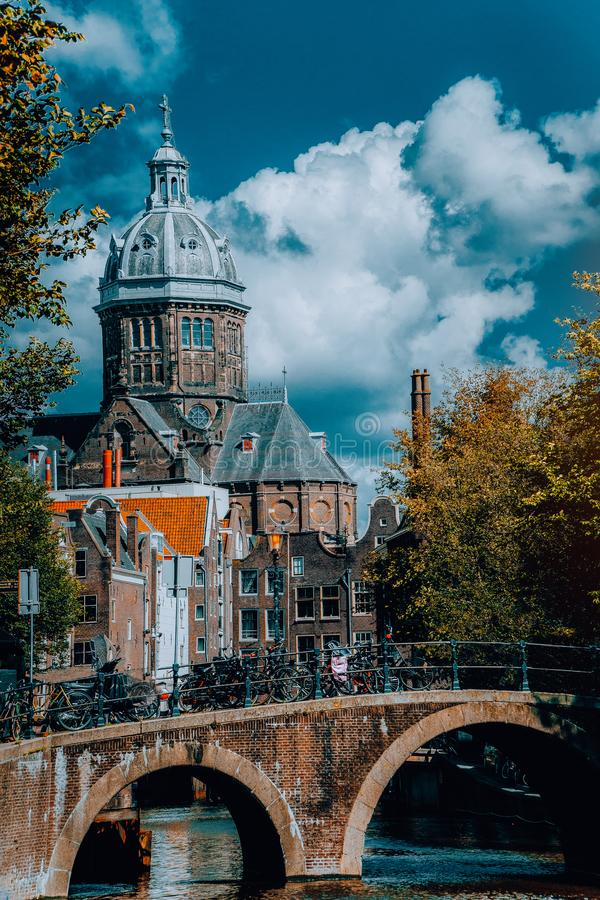 St. Nicholas Church in Amsterdam against white clouds at autumn sunny day. Amazing vibrant scenery Holland, Netherland. S stock photos