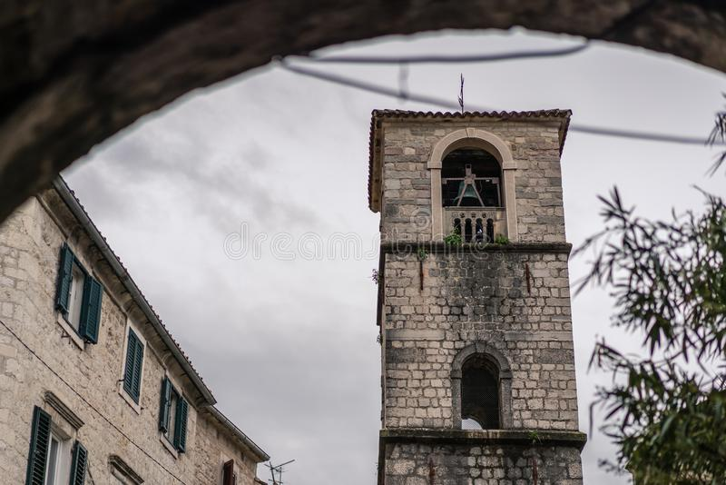 Bell tower of St. Nicholas Church in Kotor stock photography