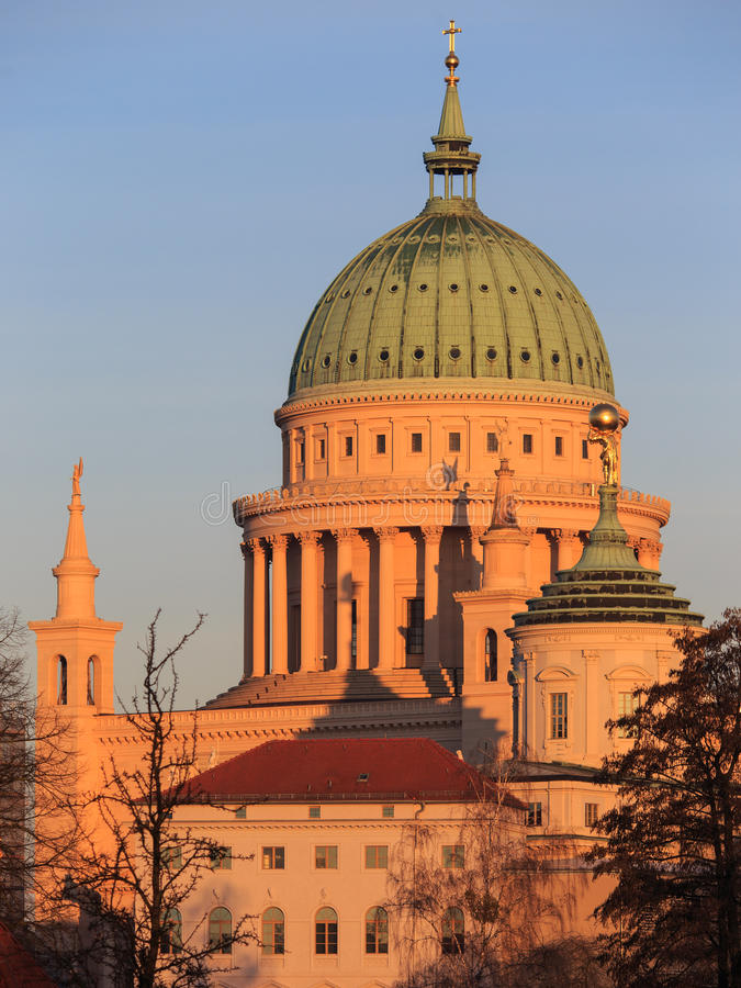 St. Nicholas' Church in Potsdam at sunrise (St. Nikolai Kirche). Dome of the St. Nicholas' Church in Potsdam at sunrise (St. Nikolai Kirche royalty free stock image
