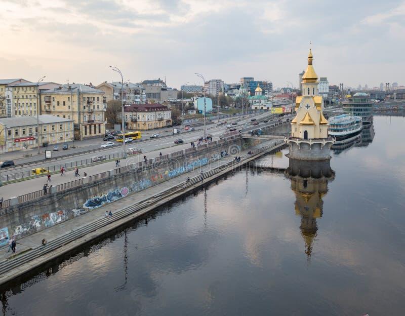 Church of Saint Nicholas on the water, old embankment and Havanskyi Bridge in Kiev, Ukraine. royalty free stock images