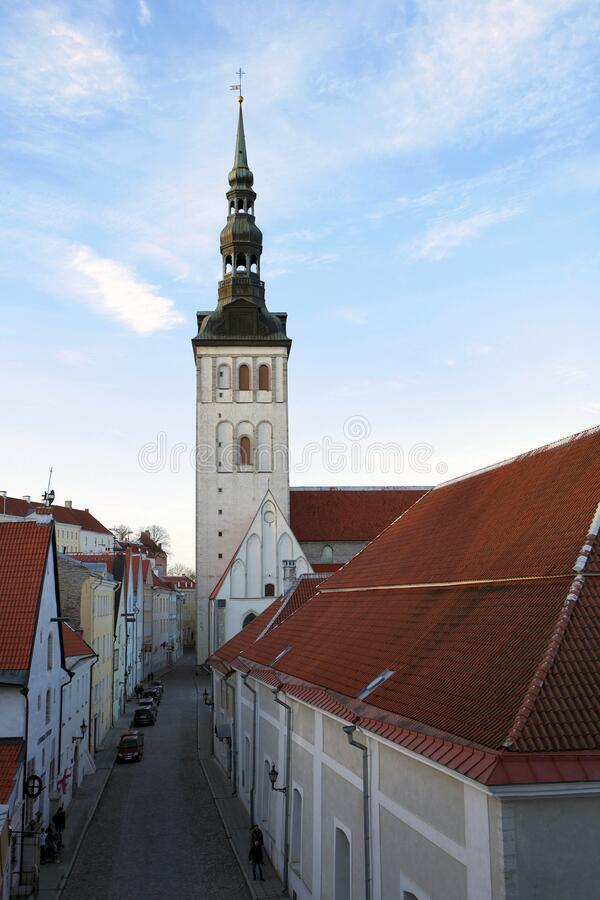 St. Olaf`s Cathedral Tower in Tallinn, Estonia. Tallinn old town street View, Estonia. UNESCO heritage in Europe. Street of old city and St. Olaf`s Cathedral royalty free stock image
