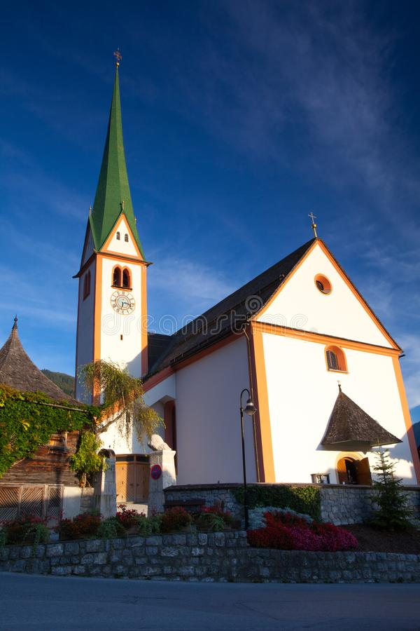 St. Oswald Parish Church in Alpbach,Austria. The church was first mentioned in 1369, a larger one was built in 1420 in honor of St. Oswald, a Northumbrian king stock images