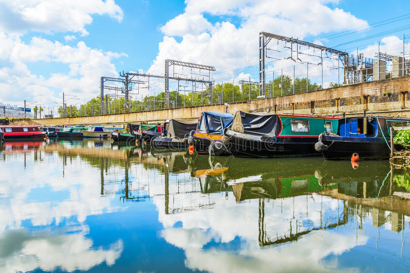 St Pancras Yacht Basin. Rows of houseboats and narrow boats on the canal banks at St Pancras Yacht Basin, part of the Regent's Canal in London stock photography