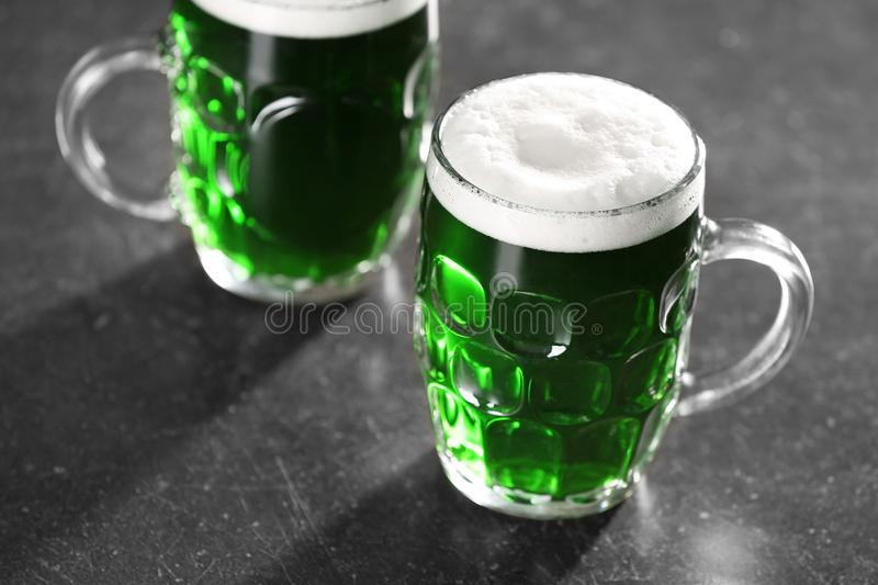 St. Patrick Day concept. Glasses of green beer. On grey table stock photo