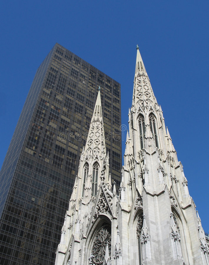 St. Patrick's Cathedral contrasts with a modern skyscraper royalty free stock images