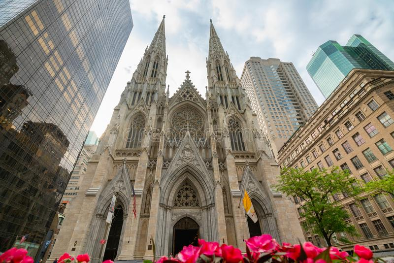 St Patrick`s Cathedral and Skyscrapers in Midtown Manhattan, NYC. St Patrick`s Cathedral, Fifth Avenue Manhattan New York City royalty free stock photos