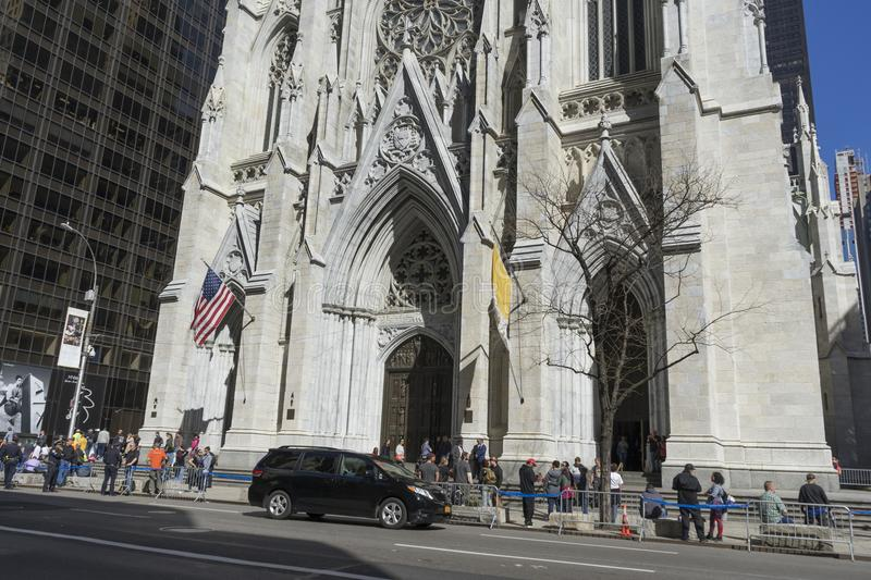 St. Patrick`s Cathedral in Manhattan, NYC. NEW YORK, USA - April 26,2018 : Crowded of tourist in front of St. Patrick`s Cathedral on 5th avenue in Manhattan, NYC stock image