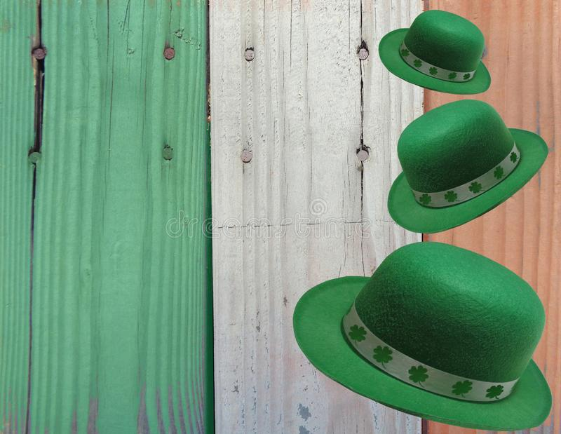 St Patrick`s Day Background of Falling Leprechaun Hats Against Irish Flag Colors royalty free stock photography