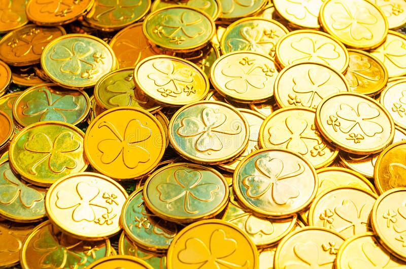 St Patrick`s Day background. Golden coins with shamrock under soft sunshine, St Patrick`s day concept stock photography