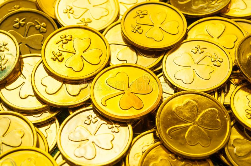 St Patrick`s Day background. Golden coins with shamrock under soft sunshine, St Patrick`s day festive concept royalty free stock photos