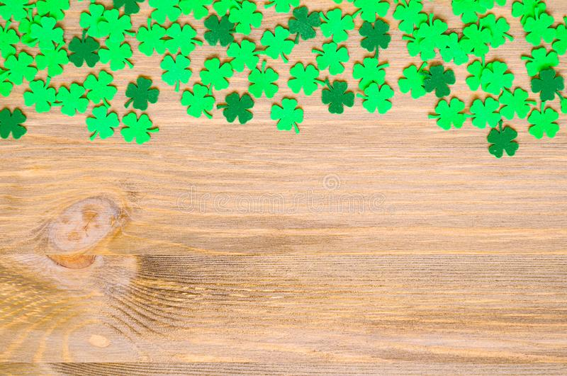 St Patrick`s Day background, one side border with green quatrefoils and space for text stock photo