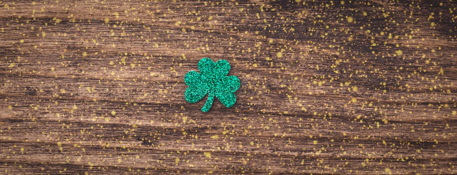 St Patrick`s day background with shamrock clover leaf, Irish festival symbol, banner. St Patrick day background with shamrock clover leaf on wood, Irish festival stock photos