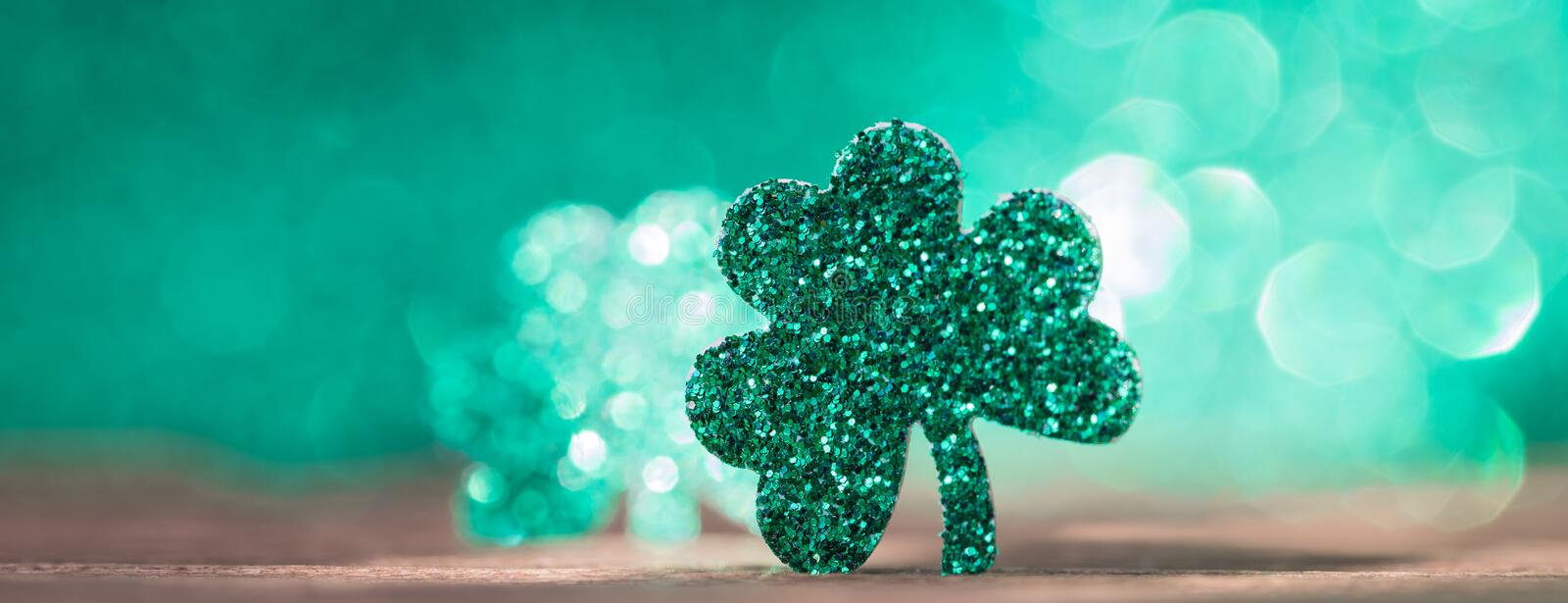 St Patrick`s day background with shamrock clover leaf, Irish festival symbol, selective focus, banner. St Patrick day background with shamrock clover leaf on royalty free stock image