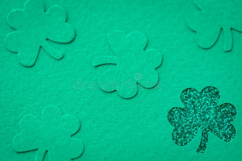 St Patrick`s day background with shamrock clover leaf, Irish festival symbol, selective focus. St Patrick day background with shamrock clover leaf on wood, Irish stock image
