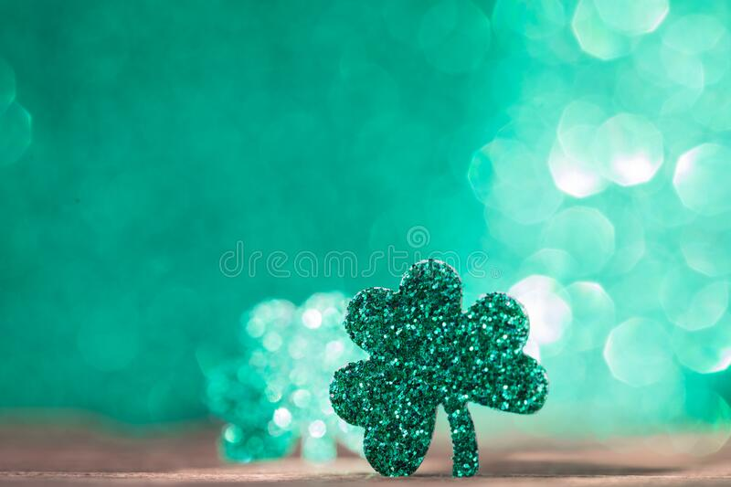 St Patrick`s day background with shamrock clover leaf, Irish festival symbol, selective focus. St Patrick day background with shamrock clover leaf on wood, Irish stock photos