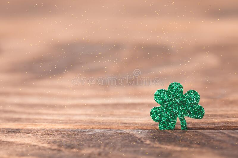 St Patrick`s day background with shamrock clover leaf on wood, Irish festival symbol, selective focus. St Patrick day background with shamrock clover leaf on stock image
