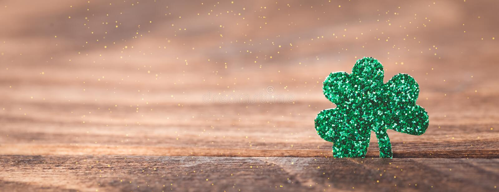 St Patrick`s day background with shamrock clover leaf on wood, Irish festival symbol, selective focus. St Patrick day background with shamrock clover leaf on royalty free stock image