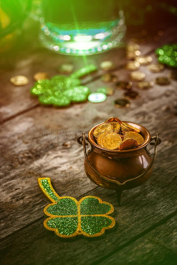 St. Patrick`s Day concept. With shamrock leaves and pot of coins royalty free stock photos