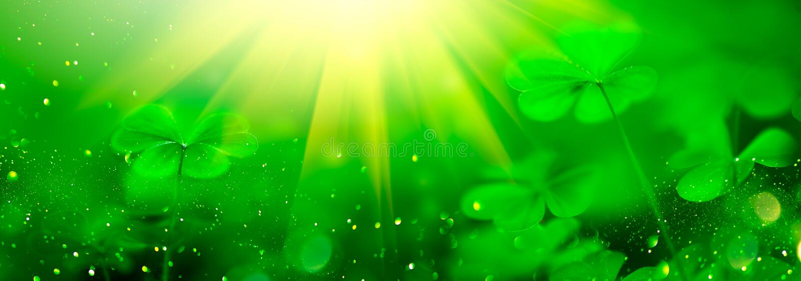 St. Patrick`s Day green blurred background with shamrock leaves. Patrick Day. Abstract border art design royalty free stock photos
