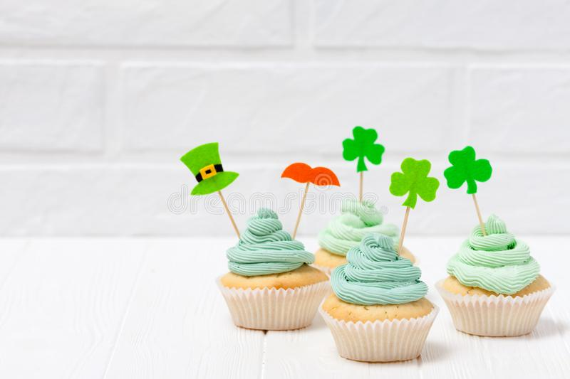 St. Patrick`s Day theme colorful horizontal banner. Cupcakes decorated with green buttercream and craft felt decorations in form royalty free stock image
